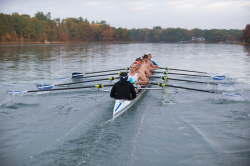 UNH Crew rowers on the river
