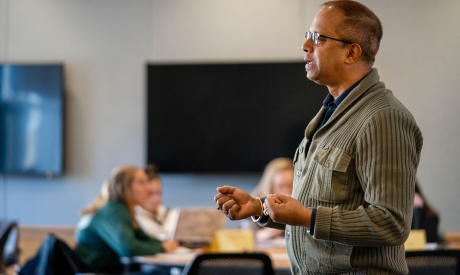 UNH faculty teaching in a UNH classroom