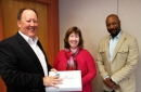Ted Anglace (Sophos), Eileen Cooley (Prize Winner), and Stan Waddel (UNH CIO)