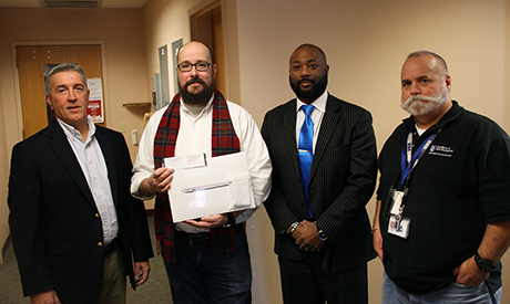 UNH Information Security Presents MacBook Air to Cyber Security Month Winner Drew Royer