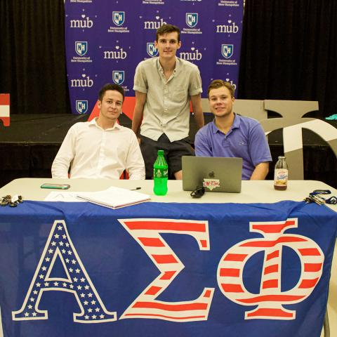 Fraternity brothers tabling