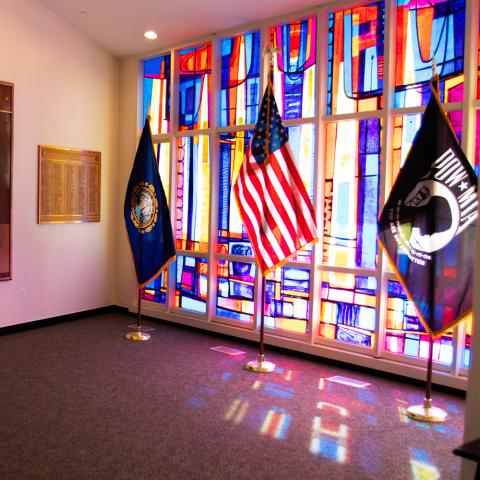 Memorial Room flags in front of stained glass window