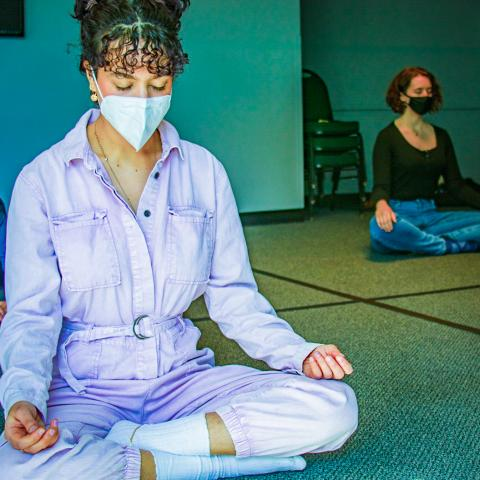 Students with masks meditating in Interfaith Space