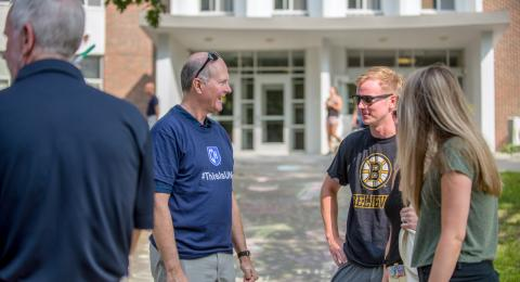 UNH President James Dean with student on campus