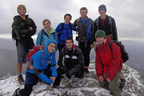Students on top of mountain in the winter