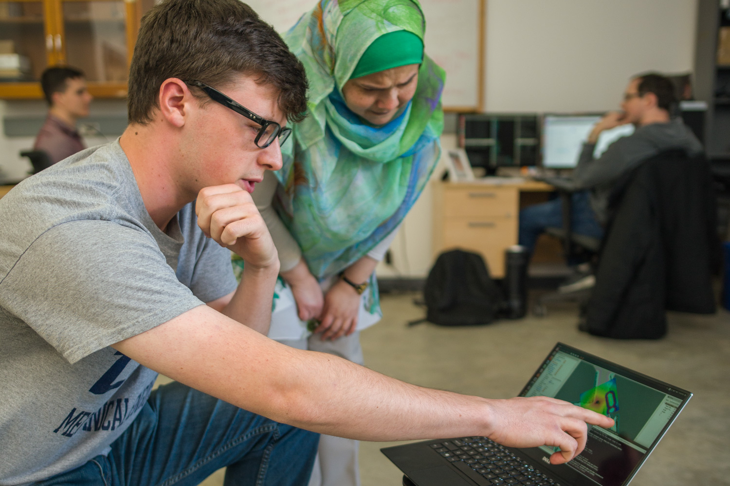 Student and faculty member conducting research