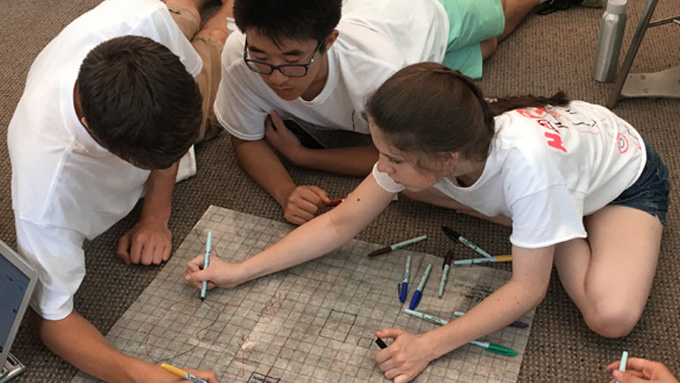 high school students working together in group activity