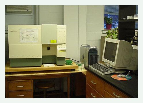 UNH's Becton-Dickinson FACSCalibur Flow Cytometer on a desk.