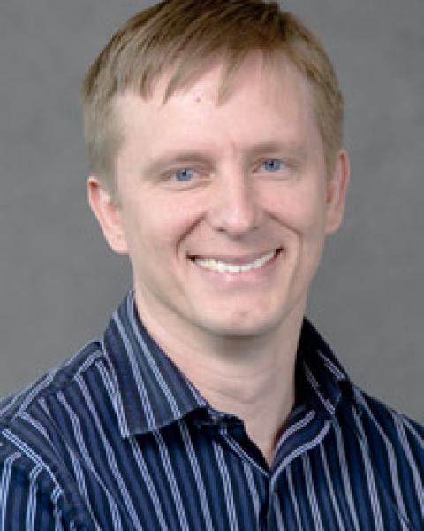 C. Andrew Glode