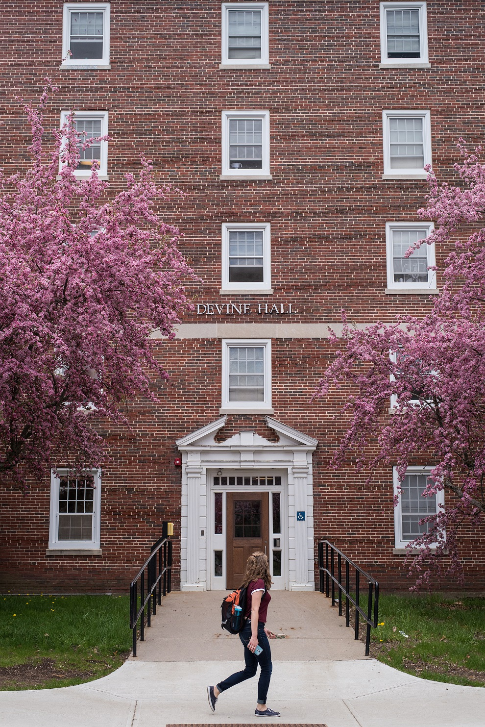 Image of student walking past Devine Hall