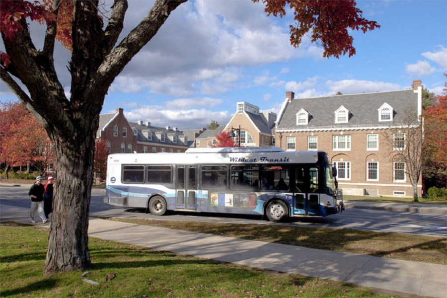 A photo of the wildcat transit bus on Durham campus