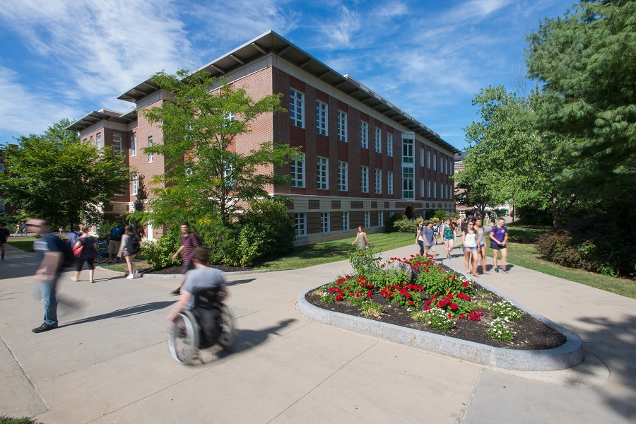 A photo of a wheelchair user on UNH Durham campus