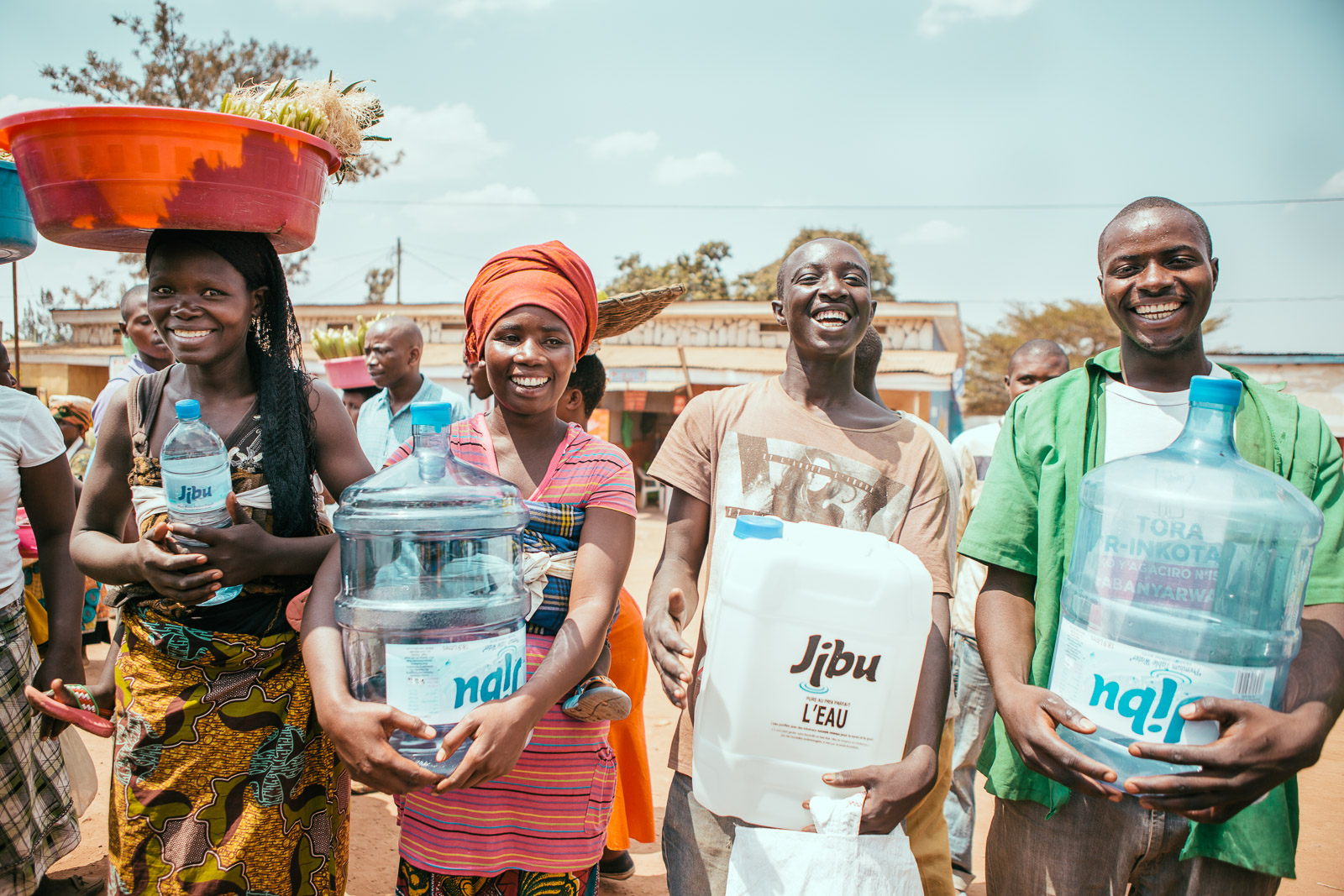 Image of four people getting water from Jibu