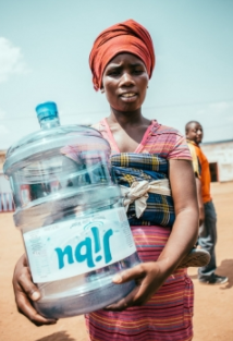 Image of Women Holding Jibu Water Bottle