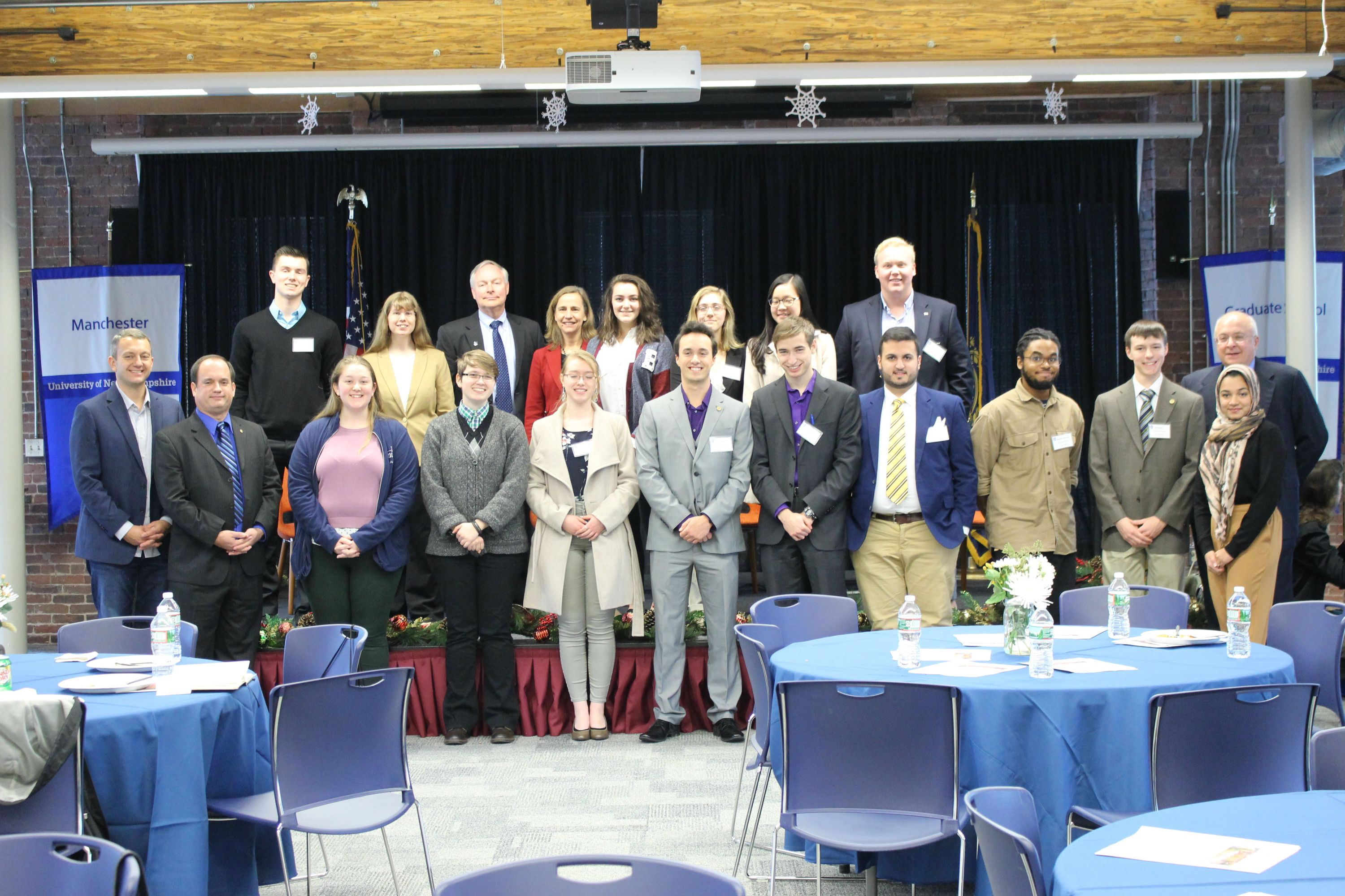 Hamel scholars, accompanied by invited guests, smile at the camera.