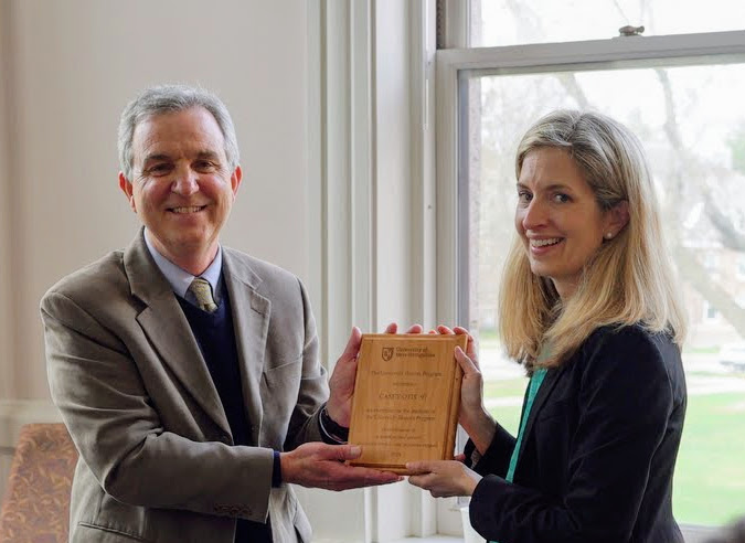 Casey Otis receiving her award from Dr. Jerry Marx