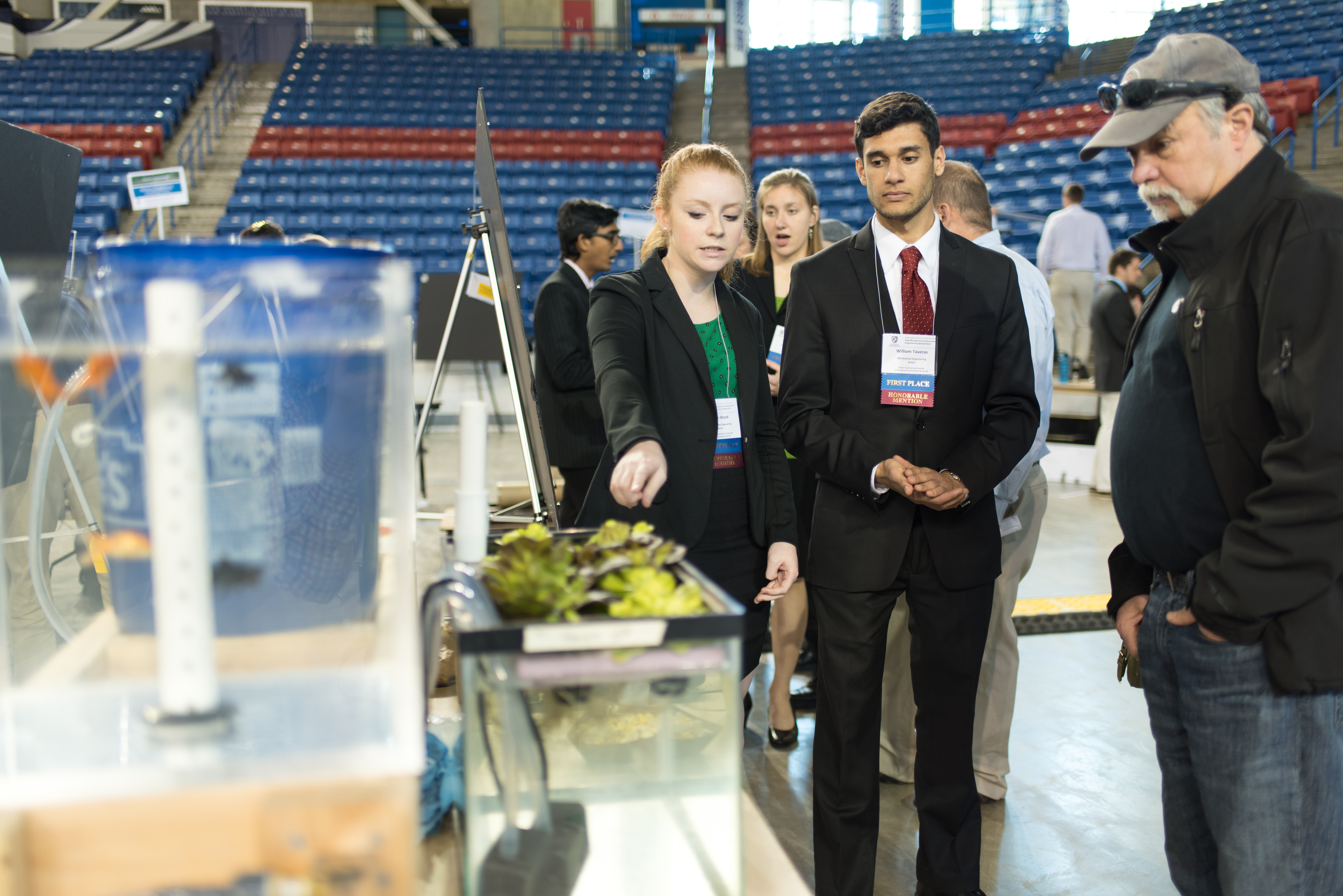 Students sharing aquaponics research at ISE Symposium