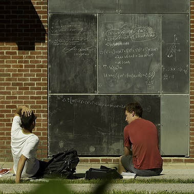 Photo of two students studying together