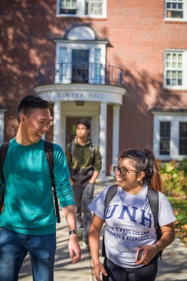 UNH Students walking together depicting student support and academic success