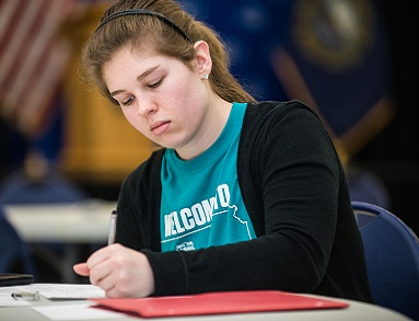 Photo of UNH student writing