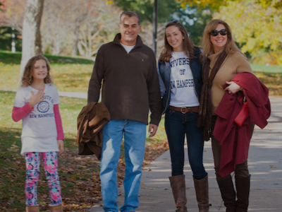 Parents and student on UNH family weekend
