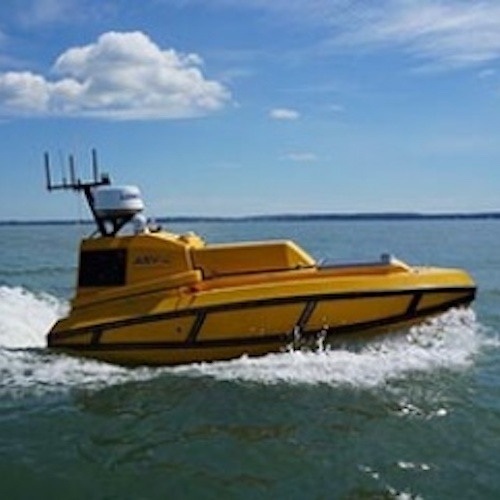 Yellow autonomous surface vehicle in the ocean