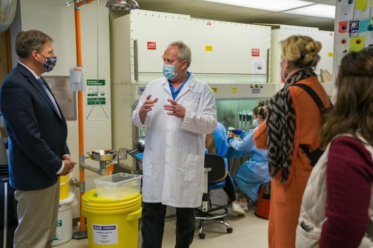 Gov. Sununu, left, tours UNH's state-of-the-art COVID 19 testing lab.