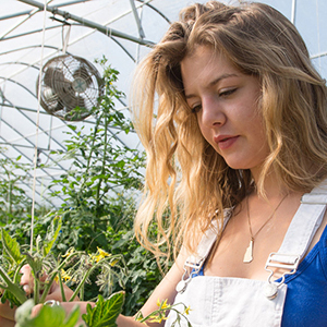 unh student in the greenhouse