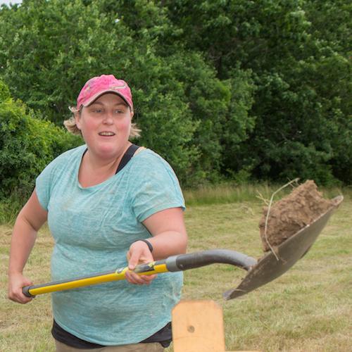 Researcher Meghan Howey in the field, shoveling