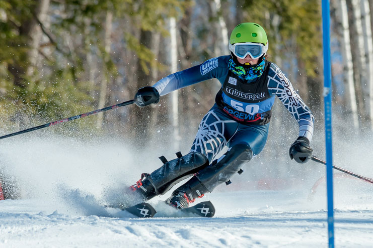 student skiing in competition