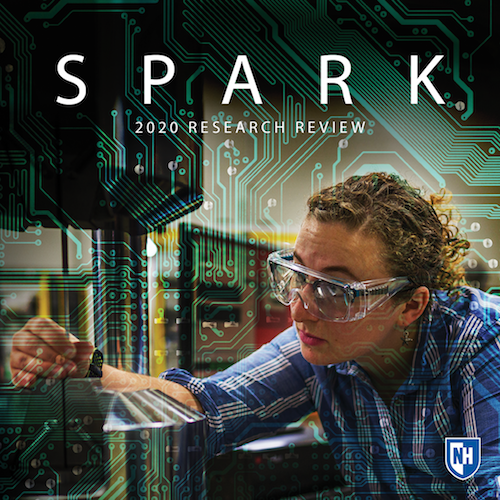 Text says Spark 2020 research review, image of woman in safety glasses working on machine