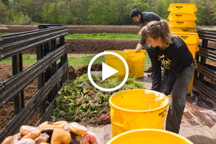 students composting dining hall food