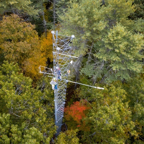 Aerial view of scientific tower in a forest