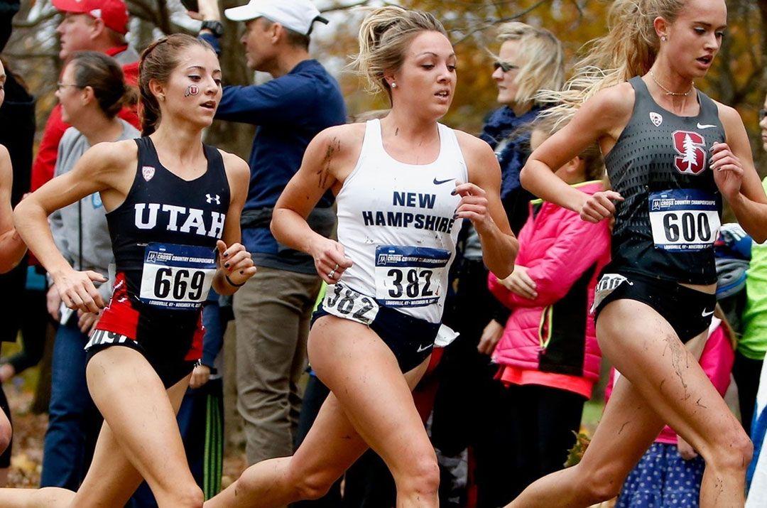 Female cross country runner in race