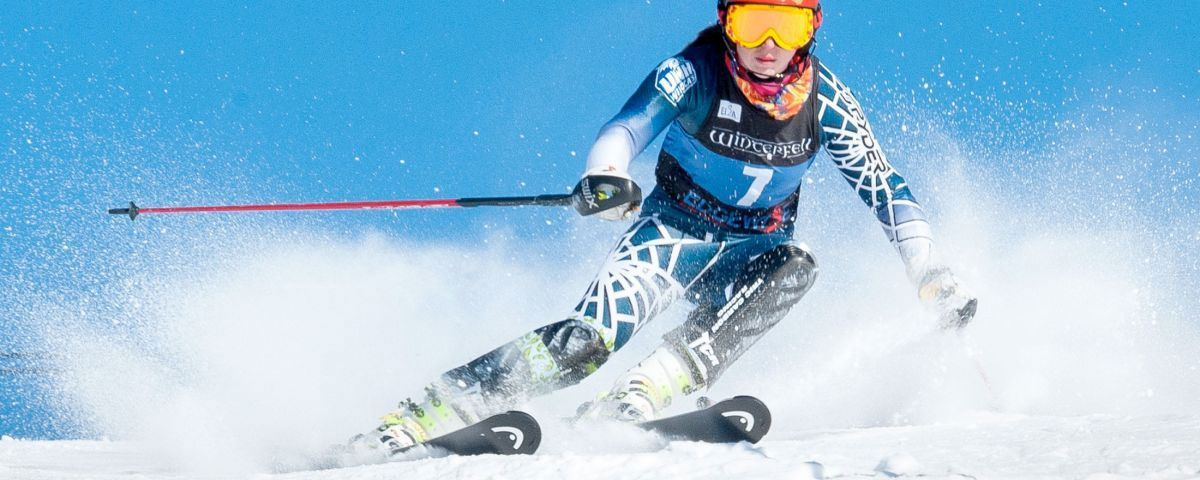 Downhill skiier during race