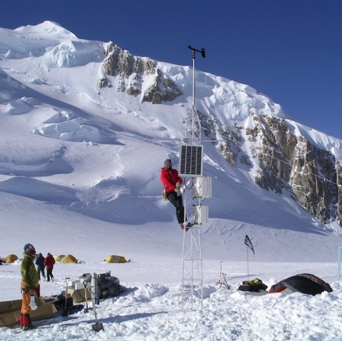 researcher on a tower in Denali Park