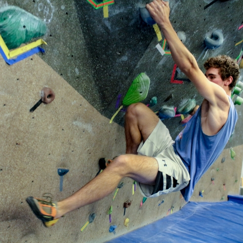 student on climbing wall