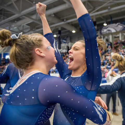 UNH gymnasts celebrating a win