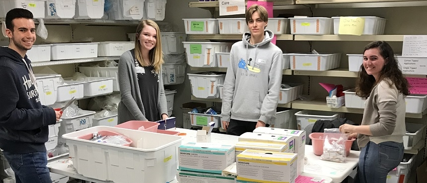 Photo of students sorting medical supplies