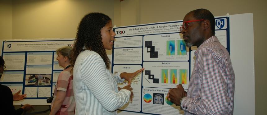 Kaylan Williams ('20) presents her research to COLA Associate Dean Reginald Wilburn at the 2019 McNair Research Symposium