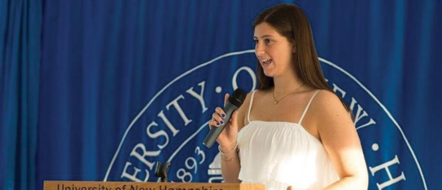 Student Body President Carley Rotenberg making a speech
