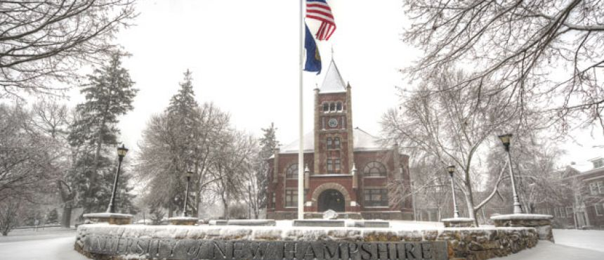 Front view of Thompson hall covered in snow.