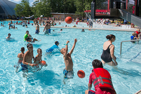 Crowds play in the water at the UNH Outdoor Pool, where Durham residents are invited to gather for a Summer Splash party.