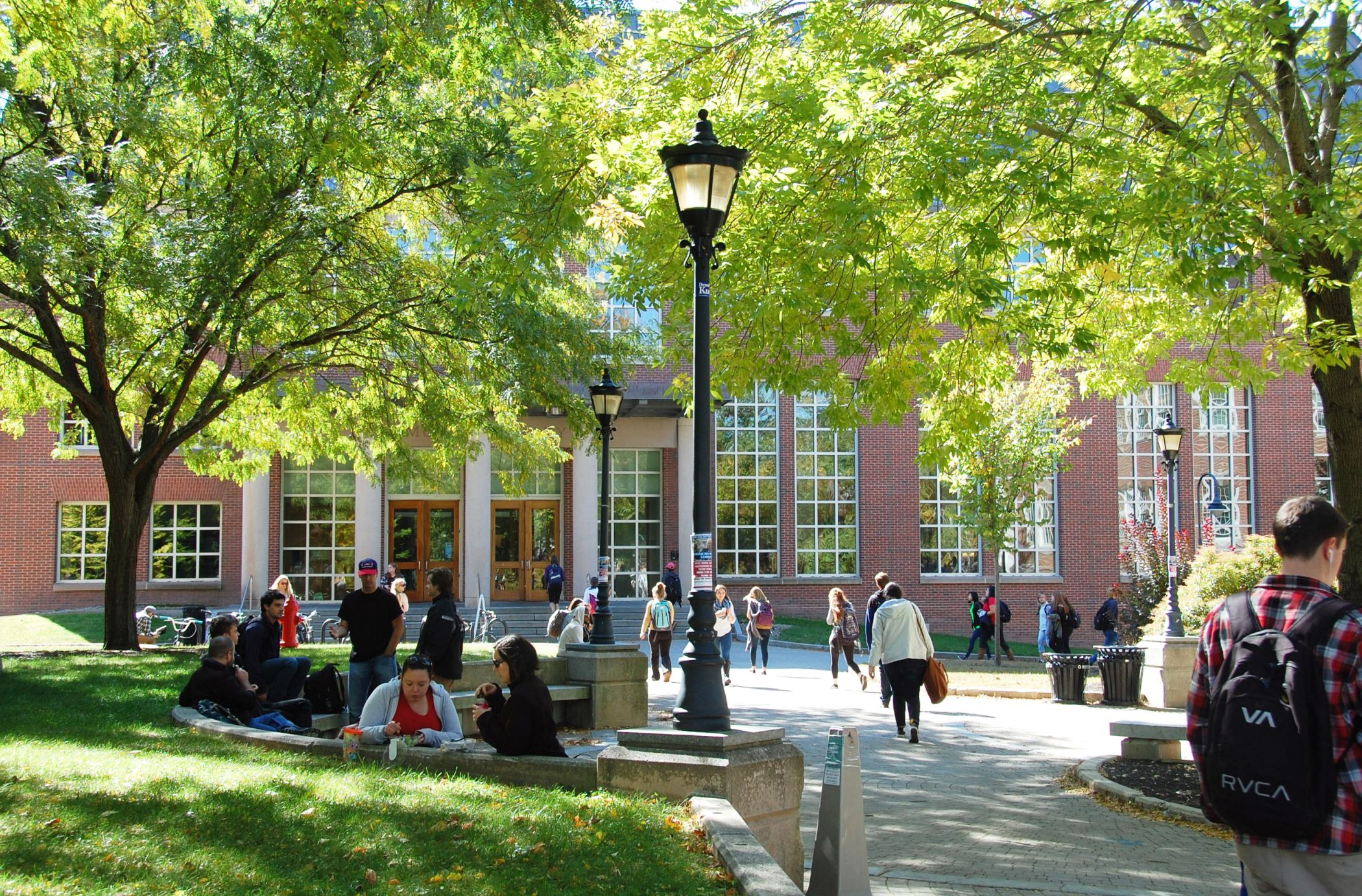 Photo of students on the UNH Campus in front of Diamond Library