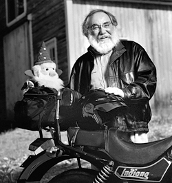 Portrait of Jeffrey Colman Salloway outside his home with his motorcycle.