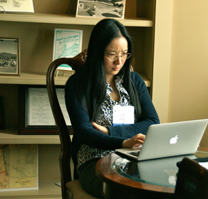 Qiaoyan Yu working on her laptop