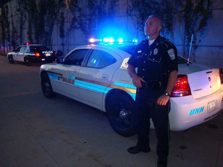 Officer with cruiser at night