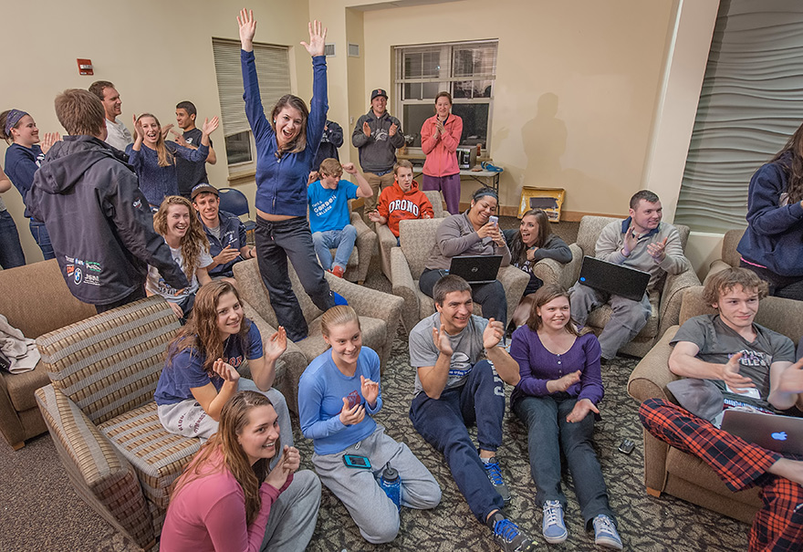 UNH students cheer watching a game