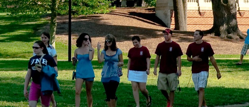 UNH students walking on campus in the summer.