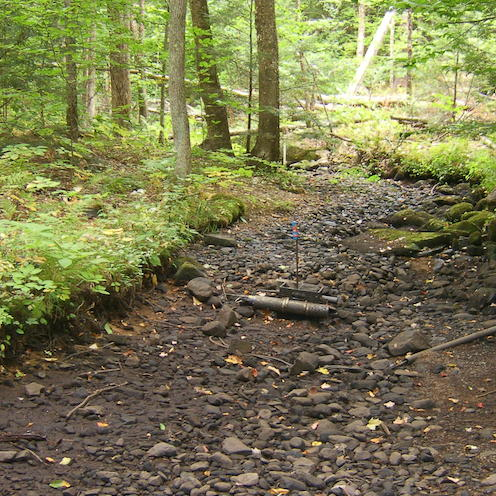 Dry stream with monitoring device in center